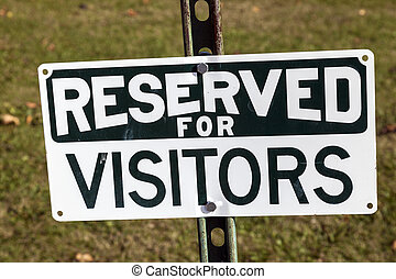 Reserved for visitors - sign seen by the landmark