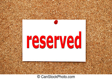 reserved sign attached to a cork board