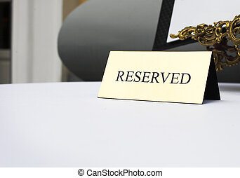 Reserved sign on the table in restaurant