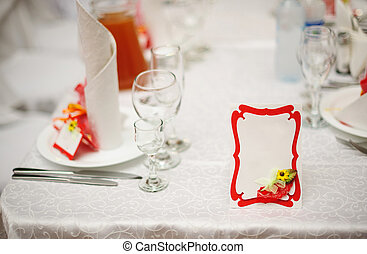 reserved table for a wedding dinner and invitation card