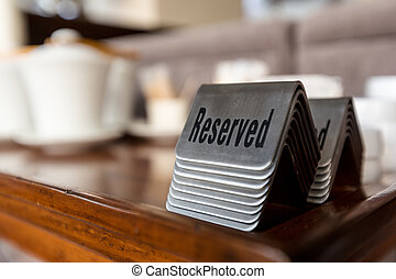 Reserved table signs - Group of reserved table signs in a ...