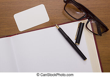 reservoarpenna, på, en öppen bok