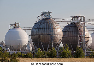 Gas and chemical refinery tanks