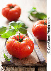 resh tomatoes on chopping board