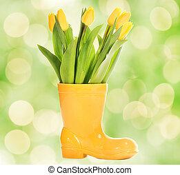 resh tulips in yellow vase