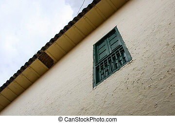 Residence wall with green window at Cuzco.