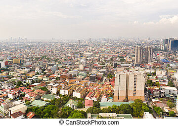 Residential areas and streets of Manila, Philippines, top view. Roofs of houses and roads.