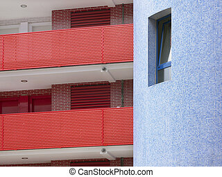 Residential building detail in red and blue tone