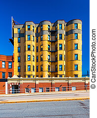 Residential building made of yellow bricks. Apartment block in the street of Boston, Massachusetts, USA. Summer day with clear blue sky.