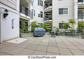Residential building. Patio area with swimming pool