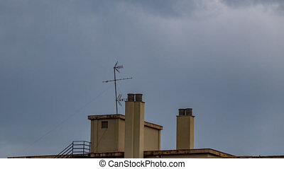 Residential building roof with chimney and antenna time ...