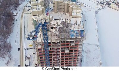 residential building site, winter, aerial view, copter shoot...