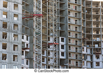 Residential building under construction, a view near the walls and windows floors