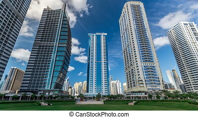 Residential buildings in Jumeirah Lake Towers timelapse in Dubai, UAE.