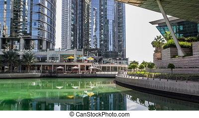 Residential buildings in Jumeirah Lake Towers timelapse in Dubai, UAE.