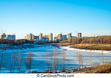 Residential buildings in winter with snow