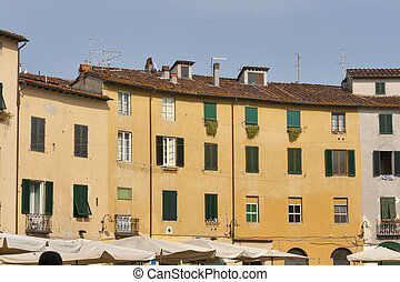 Residential buildings on oval Amphitheater Square in Lucca, Ital