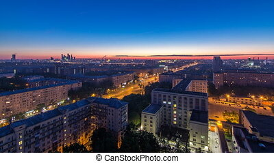 Residential buildings, Stalin skyscrapers and panorama of city before sunrise night to day timelapse in Moscow, Russia