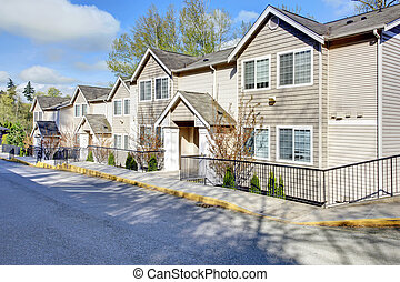 Big residential siding house with drive way