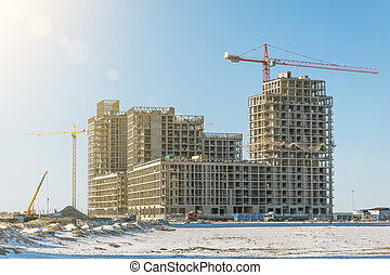 Residential complex real estate, under construction areas with high cranes