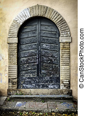 Residential doorway in  Lucca, Tuscany, Italy