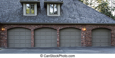 Residential Garage Doors - Four car garage doors made of...