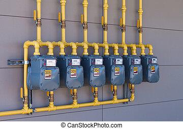 Residential gas energy meters row supply plumbing - Row of...