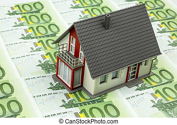residential house on bills, symbolic photo for home...