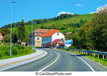 Residential houses along road in street of Maribor in Slovenia