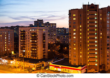 residential houses along street in spring night