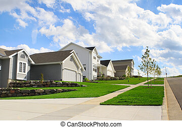 Residential Neighborhood - A row of houses in a modern...