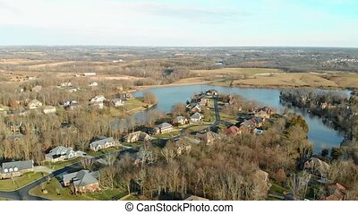 Aerial footage of residential subdivision by a lake in Central Kentucky