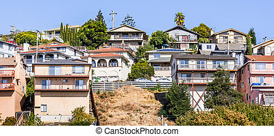Residential neighborhood with multilevel single family homes, built on a hill in San Leandro, Alameda County, East San Francisco Bay Area