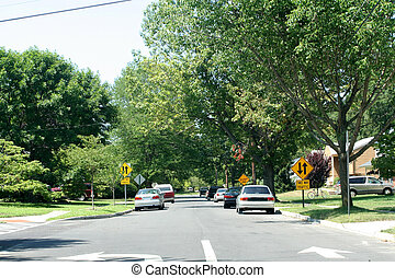 Residential Street 1 - View of a one-way street becoming a...