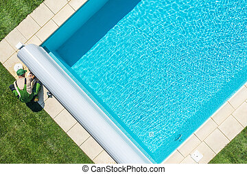 Swimming Pool Technician Cleaning Skimmer Filter