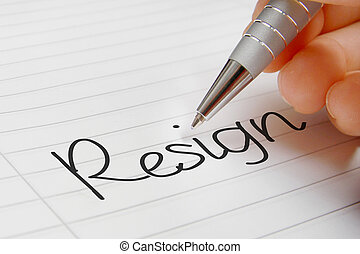 Resign word handwriting concept.