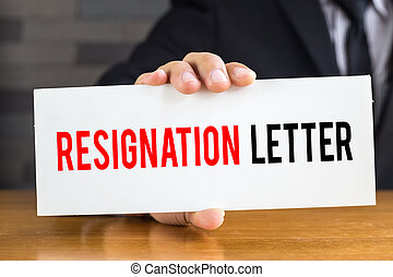 Resignation letter, message on white card and hold by...