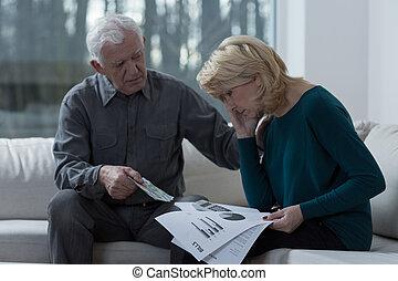 Resigned woman analyzing unpaid bills