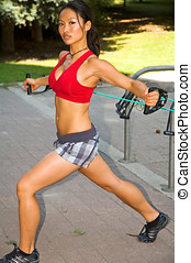 Resistance training - Fit woman using a resistance band.