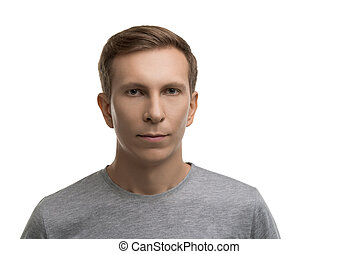 Resolute male in gray t-shirt isolated portrait