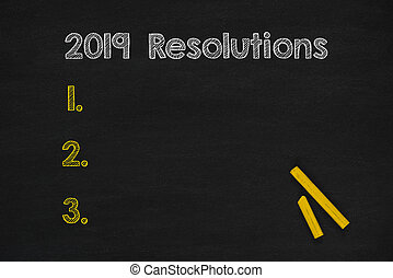 Resolutions in 2019 writings on chalkboard, Copy space...