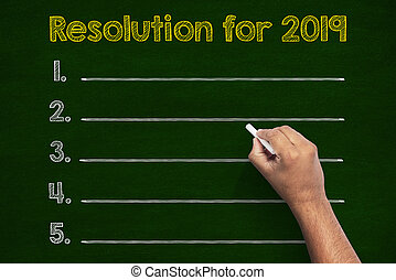 Resolutions in 2019 writings on chalkboard
