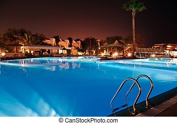 resort at night - resort with pool at night view
