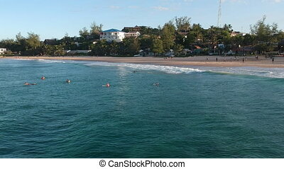 Resort Beach Panorama with Surfers in Water