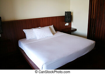 White double bed in a hotel resort
