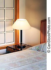 Bedroom in a resort hotel lamp and bed