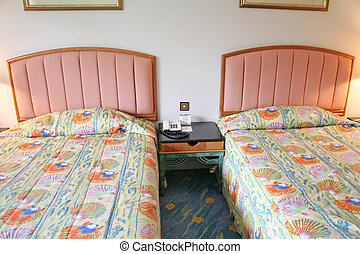 Bedroom in a resort hotel with two beds