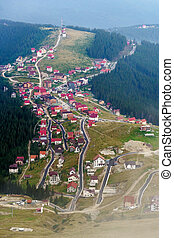 Resort between mountains and pine forests