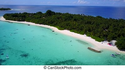 esort in maldives white sand beach tropical islands with drone aerial flying birds eye view with aqua blue sea water and sunny sky