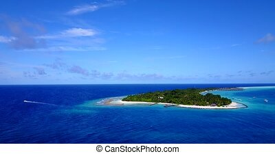 resort in maldives white sand beach tropical islands with drone aerial flying birds eye view with aqua blue sea water and sunny sky